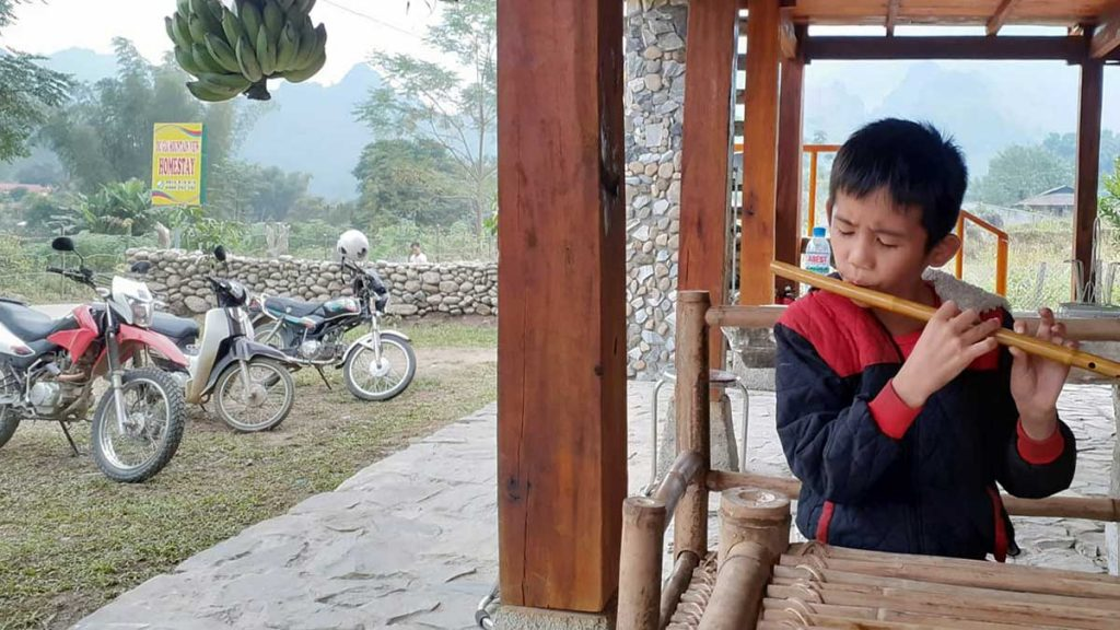 Northern Loop Boy Playing Flute Mountain View Homestay