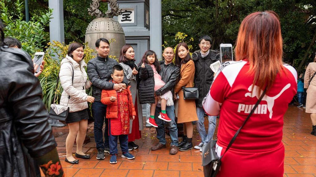 Family Takes Photo During Tet In Hanoi