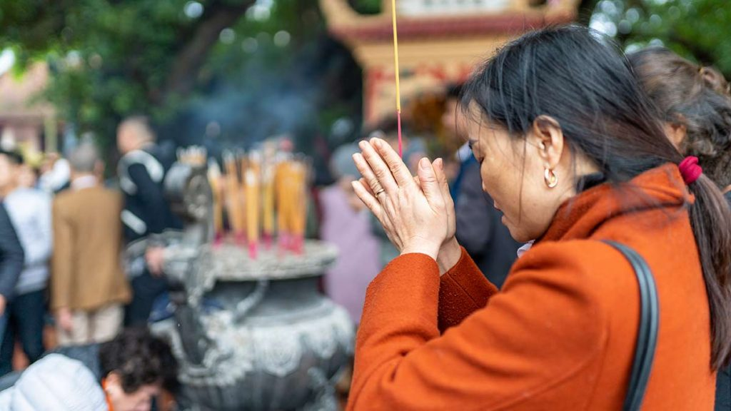 Woman Praying During Tet In Hanoi
