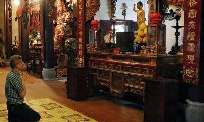 A Man Prays At Quyet Pagoda